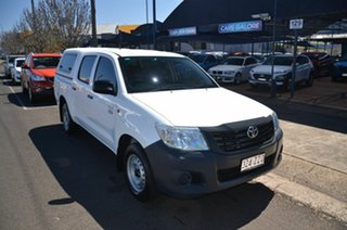2015 Toyota Hilux TGN121R Workmate White 6 Speed Automatic Dual Cab Utility.