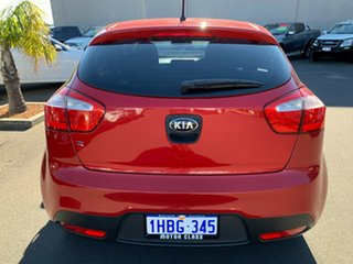 2012 Kia Rio UB MY12 SLi Red 6 Speed Manual Hatchback.