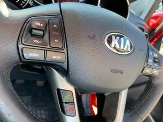2012 Kia Rio UB MY12 SLi Red 6 Speed Manual Hatchback