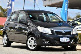 2011 Holden Barina TK MY11 Black 5 Speed Manual Hatchback.