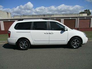 2013 Kia Grand Carnival VQ MY13 SLi White 6 Speed Sports Automatic Wagon.