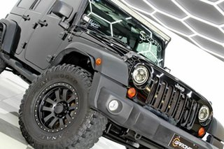 2010 Jeep Wrangler Unlimited JK MY09 Sport (4x4) Black 4 Speed Automatic Softtop.