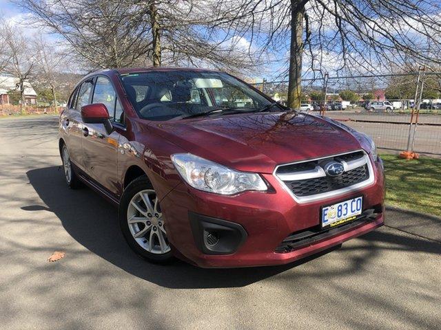 Used Subaru Impreza G4 MY14 2.0i AWD Launceston, 2014 Subaru Impreza G4 MY14 2.0i AWD Burgundy 6 Speed Manual Hatchback