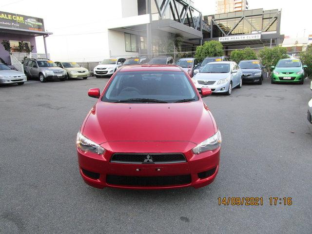 Used Mitsubishi Lancer CJ MY11 SX Coorparoo, 2010 Mitsubishi Lancer CJ MY11 SX Red 5 Speed Manual Sedan