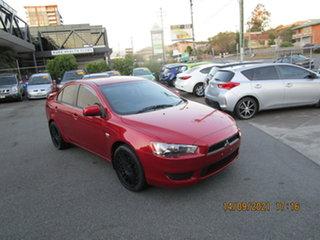 2010 Mitsubishi Lancer CJ MY11 SX Red 5 Speed Manual Sedan.