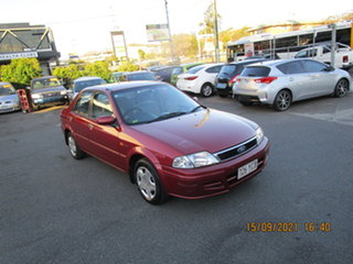 2001 Ford Laser KN LXI Red 4 Speed Automatic Sedan.