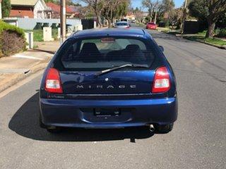 2002 Mitsubishi Mirage CE MY2002 Blue 5 Speed Manual Hatchback.