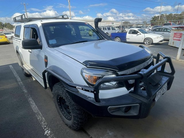 Used Ford Ranger PK XL (4x4) Traralgon, 2011 Ford Ranger PK XL (4x4) White 5 Speed Manual Dual Cab Chassis