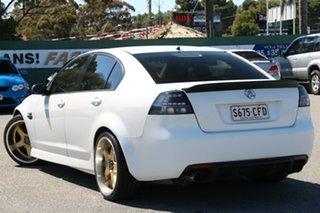 2006 Holden Commodore VE Omega White 4 Speed Automatic Sedan.