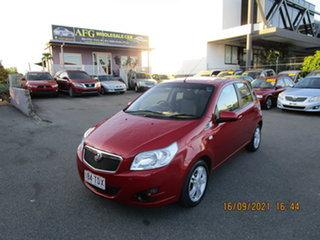 2011 Holden Barina TK MY11 Red 4 Speed Automatic Hatchback.