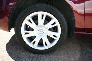 2011 Mazda 2 DE MY10 Neo Red 5 Speed Manual Hatchback.