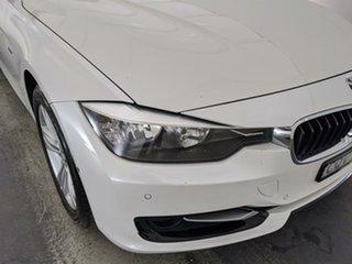2013 BMW 3 Series F31 MY1112 318d Touring White 6 Speed Manual Wagon.