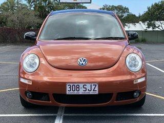 2010 Volkswagen Beetle 9C MY2010 BlackOrange Coupe Orange 6 Speed Sports Automatic Liftback