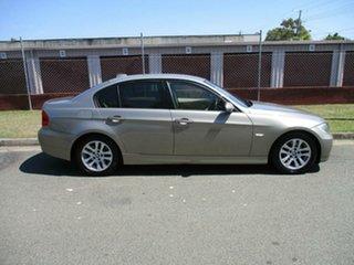 2008 BMW 3 Series E90 MY08 320i Steptronic Executive Gold 6 Speed Sports Automatic Sedan.