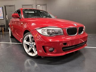 2011 BMW 1 Series E82 LCI MY11 120i Steptronic Red 6 Speed Sports Automatic Coupe.