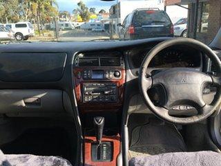 1999 Mitsubishi Verada KH XI Gold 4 Speed Automatic Sedan