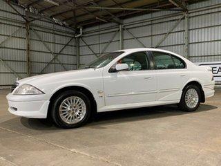 1998 Ford Fairmont AU Ghia White 4 Speed Automatic Sedan.