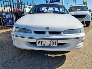 1995 Holden Commodore VR II Berlina White 4 Speed Automatic Sedan.