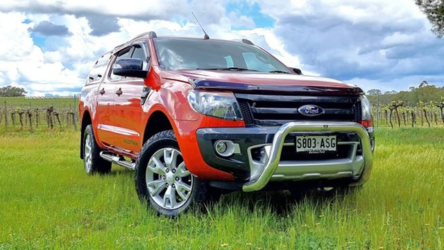 Used Ford Ranger PX Wildtrak Double Cab Nuriootpa, 2012 Ford Ranger PX Wildtrak Double Cab Chilli Orange 6 Speed Manual Utility