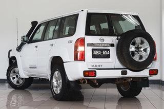 2012 Nissan Patrol GU 7 MY10 ST White 5 Speed Manual Wagon.