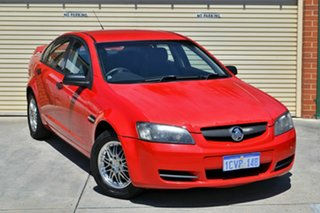 2006 Holden Commodore VE Omega Red 4 Speed Automatic Sedan.