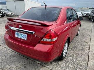 2006 Nissan Tiida C11 ST-L Red 6 Speed Manual Sedan.