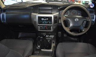 2010 Nissan Patrol GU VI DX (4x4) White 5 Speed Manual Wagon.