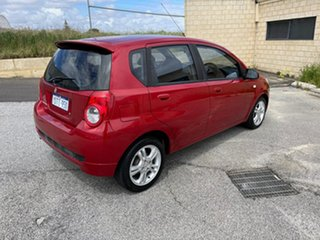 2011 Holden Barina TK MY11 Red 5 Speed Manual Hatchback