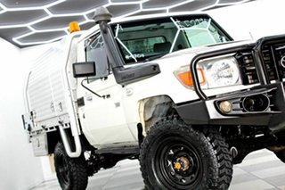 2014 Toyota Landcruiser VDJ79R MY12 Update Workmate (4x4) White 5 Speed Manual Cab Chassis.