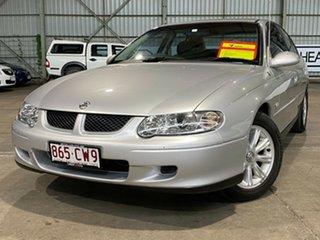 2002 Holden Commodore VX II Equipe Silver 4 Speed Automatic Sedan.