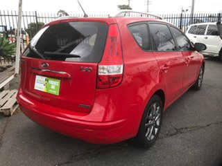 2011 Hyundai i30 FD MY11 CW SLX 1.6 CRDi Red 4 Speed Automatic Wagon.