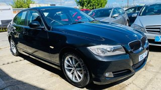2010 BMW 3 Series E90 MY10 320d Steptronic Executive Black 6 Speed Sports Automatic Sedan.