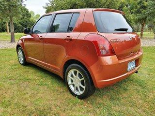 2007 Suzuki Swift RS415 Orange 5 Speed Manual Hatchback.