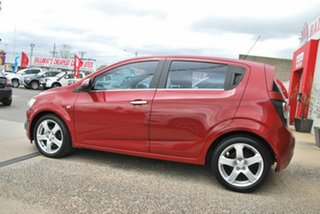 2013 Holden Barina TM MY13 CDX Red 6 Speed Automatic Hatchback.