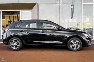 2021 Hyundai i30 PD.V4 MY22 Phantom Black 6 Speed Sports Automatic Hatchback.