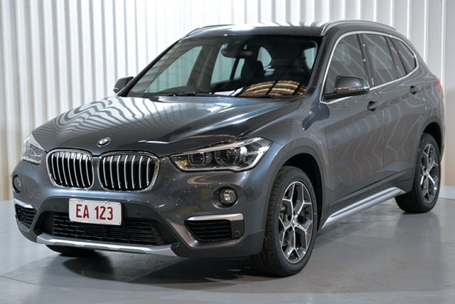 Used BMW X1 F48 sDrive18i D-CT Hendra, 2019 BMW X1 F48 sDrive18i D-CT Grey 7 Speed Sports Automatic Dual Clutch Wagon