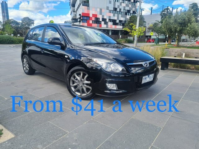 Used Hyundai i30 FD MY11 SX South Melbourne, 2011 Hyundai i30 FD MY11 SX Black 6 Speed Manual Hatchback
