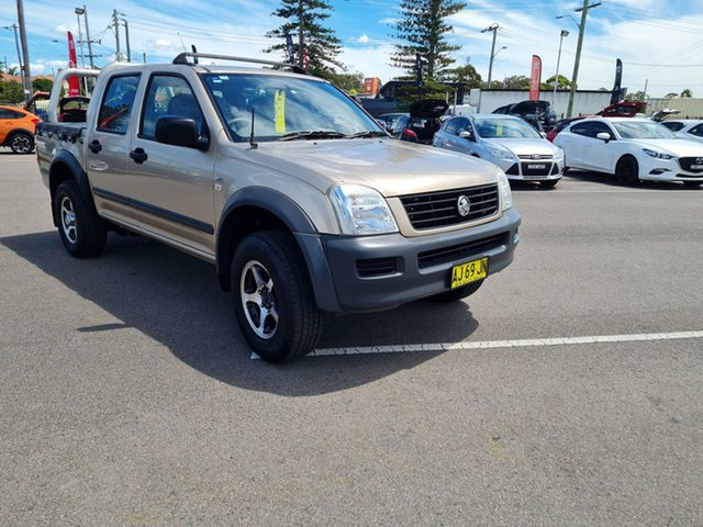 Pre-Owned Holden Rodeo RA MY06 LX Crew Cab Cardiff, 2006 Holden Rodeo RA MY06 LX Crew Cab Gold 4 Speed Automatic Utility
