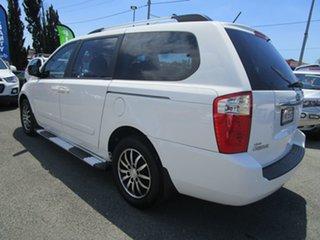 2012 Kia Grand Carnival VQ MY12 SLi White 6 Speed Sports Automatic Wagon.
